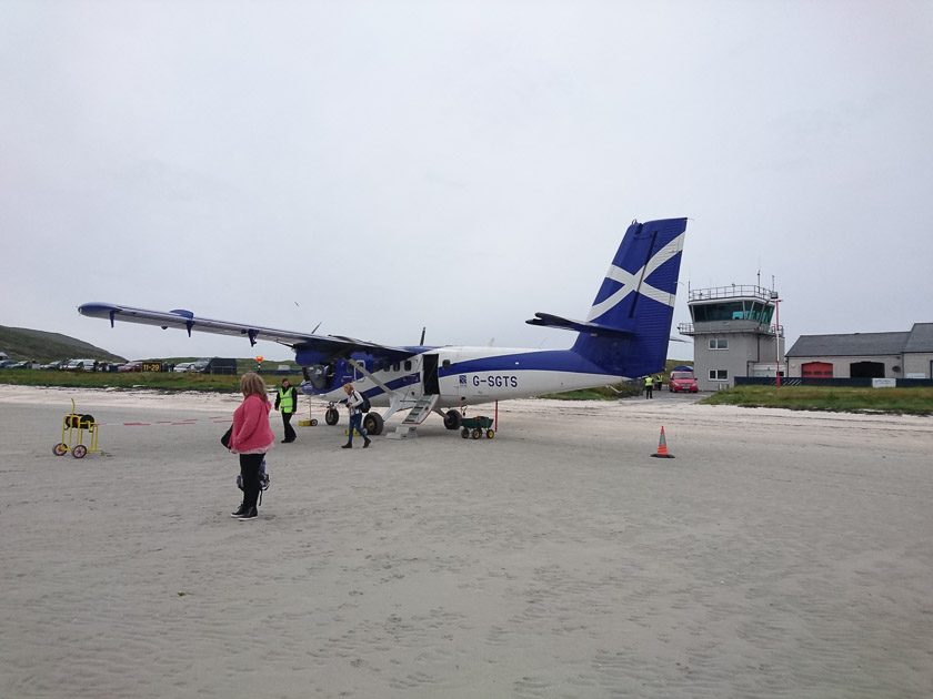 A Twin Otter plane on the Traigh Mhor in Barra, Outer Hebrides, UK.