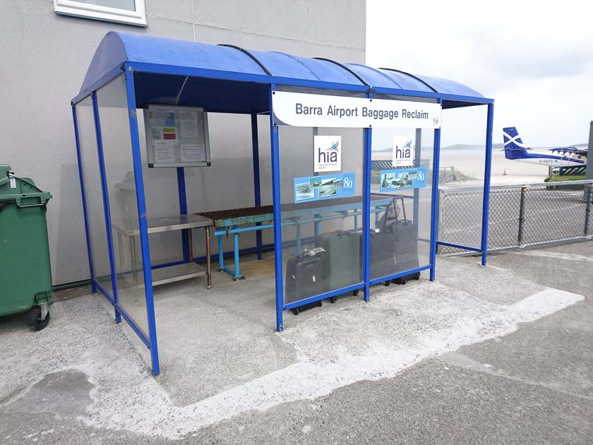 The baggage reclaim shelter at Barra Airport. It's like a small bus shelter.