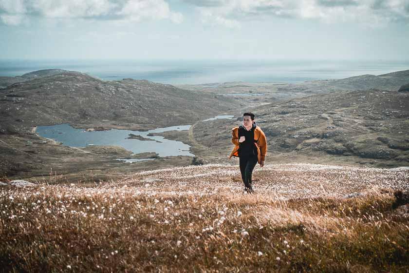 Andy climbing Beinn Chliaid, Barra