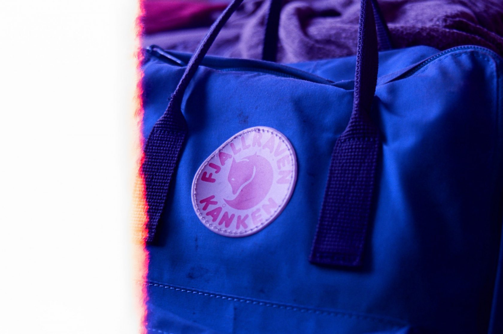 A close-up image of a Fjällräven Kånken backpack logo