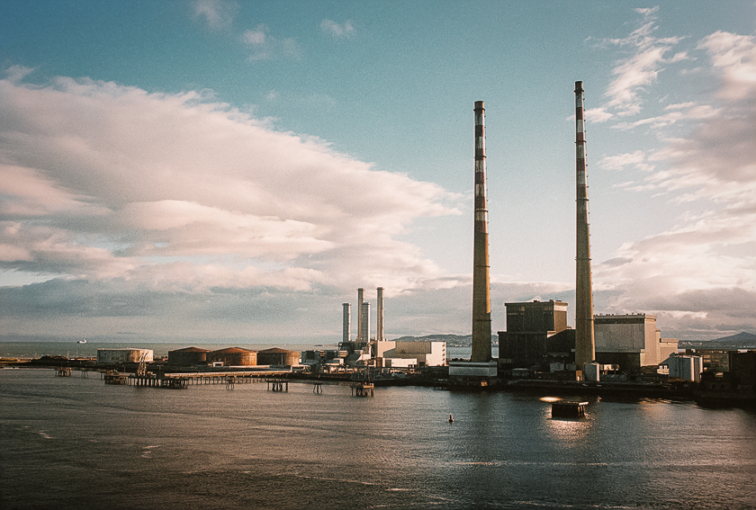 A factory in Dublin harbour at sunset