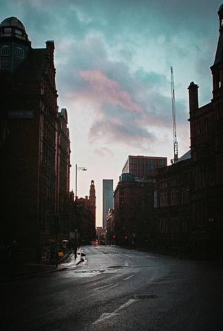 Looking down Sackville Street in Manchester, towards the Deansgate Square towers at sunset
